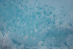 Ice floes turned around by the moving icebreaker frequently show a rotten appearance due to the melting processes occurring in all levels of the ice s Photo