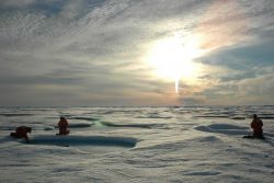 Scientists working on the ice beneath the midnight sun. Photo