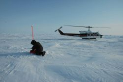 Placing an ice beacon that measures air temperature and pressure and monitors motion of ice Photo
