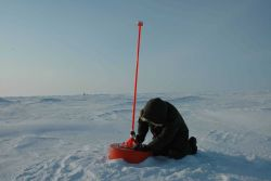 Placing an ice beacon that measures air temperature and pressure and monitors motion of ice. Photo