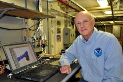 Captain Andy Armstrong, NOAA Corps (ret.), displaying a newly discovered Arctic seamount. Photo