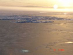 New ice formed over a polynya with ice ridges and mult-year ice in distance. Photo