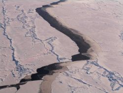 A lead through the ice pack with different types of ice as seen from a helicopter Photo