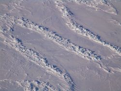Parallel ridges with huge blocks of blue green ice thrown up Photo