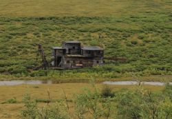 A deserted gold dredge along the Nome to Council road. Image