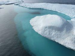Aquamarine subsurface of ice floe. Image