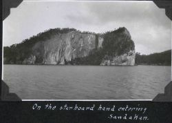 When entering Sandakan Harbor it would seem that it is best to keep this rock on the right hand. Photo