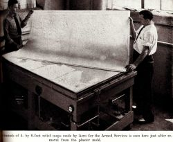One of thousands of 4- X 6 foot relief models made by Aero for the armed forces is seen here just after removal from the plaster mold Photo