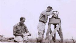 Oscar Risvold recording while Lieutenant William Tucker observses angles. Photo