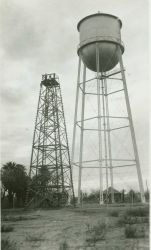 A large wooden tower on an Arizona Station next to a water tank Image