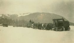 A tractor carrying fuel in central Alaska. Image