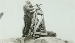 Setting up the theodolite to make observations. Photo