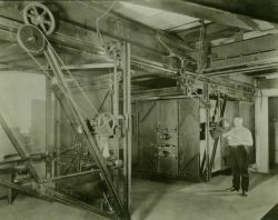 Operating the 50-inch camera which was invented by Lieutenant Otis Reading during the 1930's Photo