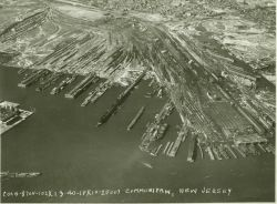Aerial view of Communipaw, Jersey City, New Jersey showing rail lines, piers, and ferry terminal (at lower right of photo.) Photo