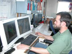 Processing hydrographic data on board the NOAA Ship RAINIER. Photo