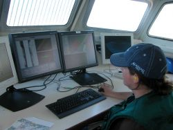 Monitoring both side scan and multi-beam data acquisition systems while doing launch hydrography off the NOAA Ship RAINIER. Photo
