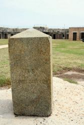 Granite obelisk used to designate one of the end points of the baseline measured by Alexander Dallas Bache on Dauphin Island in 1847 Photo