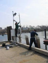 Level operations in support of Long Island Sound tide gauge. Photo