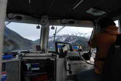 Coxswain operating Jensen survey launch Photo