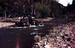 Truck fording the Gila River Photo