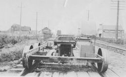 Configuration of speeder used in leveling operations along railroad. Photo