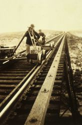 Crossing a trestle during leveling operations Photo