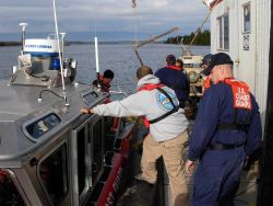 NOAA Navigation Response Team member and Coast Guard personnel preparing for cooperative work outside of Eastport, Maine. Photo