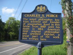 Roadside history marker noting Arisbe, the home of Charles Sanders Peirce, son of Benjamin Peirce, and considered one of America's greatest philosophe Photo