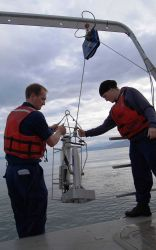 Deploying survey gear from stern of launch. Photo