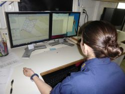 Ensign Micki Ream working on survey planning on NOAA Ship RAINIER. Photo