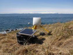 GOES satellite antenna and solar panel used in transmitting tidal data to satellite and thence to processing center. Photo