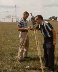 Surveyor taking sun azimuth for true direction to determine magnetic declination from magnetic observations. Photo