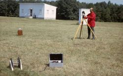 Calibrating geomagnetic instruments at the Coast and Geodetic Survey geomagnetic observatory at Corbin, Virginia. Photo