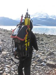 Backpacking horizontal control material to station site. Photo