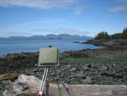 Transmitter antenna for uploading tidal data to a GOES satellite for downloading to a processing center. Photo