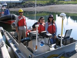 Small work boat outfitted with Trimble GPS GPS receiver used in shoreline mapping. Photo