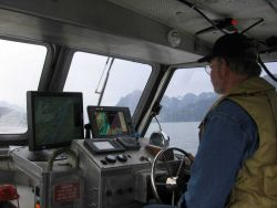 Besides staying on line, the coxswain of a modern survey launch has to monitor a number of parameters. Photo