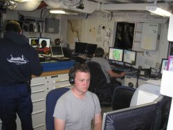 Processing survey data in the plot room of the NOAA Ship FAIRWEATHER. Photo