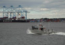 NOAA survey launch BAY HYDROGRAPHER underway at container piers at Portsmouth, Virginia, within hours of Sandy's departure Photo