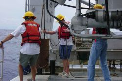 Deploying pipe dredge during Charleston Bump Expedition. Photo