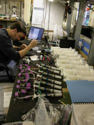 Nathan Buck works on preparing his Automated Trace Element samplers to collect water at different depths for trace metal testing. Photo