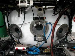 A closeup of the three viewports on the front of the PISCES V submersible which was the main vehicle used to explore the submarine volcanoes of the Ke Photo