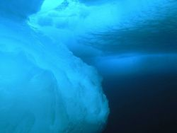 Photos taken underneath the ice surface show both the complexity of the ice structure as well as the stunning shades of blue Photo