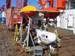 Andy Billings, an engineering assistant at Woods Hole Oceanographic Institution, makes final checks on ABE (the autonomous benthic explorer) leading u Photo