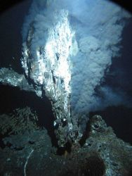 A black smoker chimney named 'Boardwalk' emitting hydrothermal fluids at 644 F (340 C) in the northeastern Pacific Ocean at a depth of 7,260 feet Photo