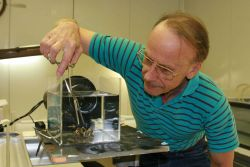 Researcher Henry Vanderploeg, of NOAA's Great Lakes Environmental Laboratory, analyzes invasive non-native mussels. Photo