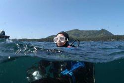 Dave McMahan, Alaska State Archaeologist, surfacing from dive on Kad'yak. Photo