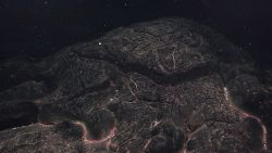 A recent pillow lava flow with biological material resting between the pillows, indicating where low-temperature hydrothermal fluid has been leaking o Image