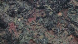 Closeup of the surface of an extinct hydrothermal spire probably composed of various sulfide minerals Photo