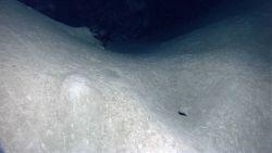 A deep hole and a large mound Image